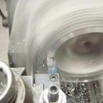 Machine lathe resurfacing Porsche 993 heads at TPC Racing