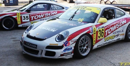 two parked Porsche 997 GT3 cup cars with TPC Racing race livery