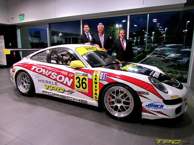 Mike Levitas of TPC Racing posing with his GT3 Cup Car at Porsche of Towson